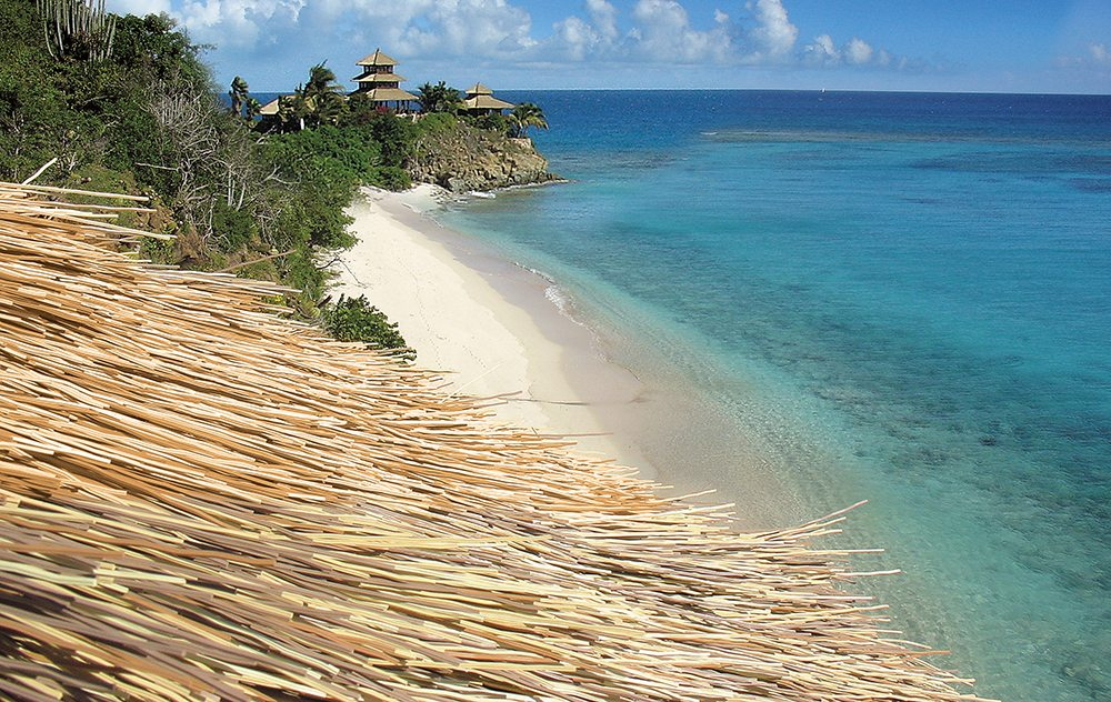 South Pacific synthetic thatch. Solar panels on natural thatch?